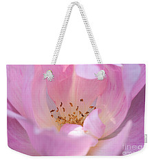 Weekender Tote Bag featuring the photograph Pink Swirls by Todd Blanchard