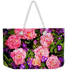 Weekender Tote Bag featuring the photograph Pink Tulips With Purple Flowers by James Steele