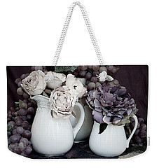 Weekender Tote Bag featuring the photograph Pitchers And Tapestry by Sherry Hallemeier