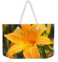 Weekender Tote Bag featuring the photograph Pizzazz by Maria Urso