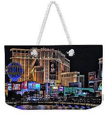 Planet Hollywood And Paris At Las Vegas Weekender Tote Bag by Walt Foegelle