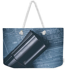 Weekender Tote Bag featuring the photograph Planning The Heist by Edward Fielding