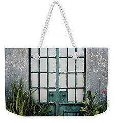 Weekender Tote Bag featuring the photograph Plants In The Doorway by Marco Oliveira