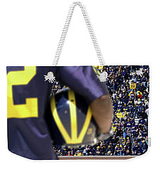 Player Cradling Helmet In Stadium Weekender Tote Bag