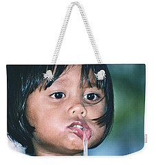 Weekender Tote Bag featuring the photograph Playful Little Girl In Thailand by Heiko Koehrer-Wagner