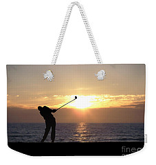 Weekender Tote Bag featuring the photograph Playing Golf At Sunset by Phil Perkins