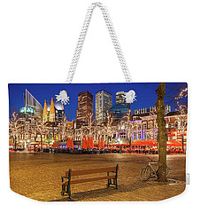 Weekender Tote Bag featuring the photograph Plein Square At Night - The Hague by Barry O Carroll