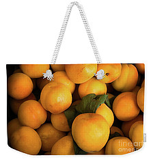 Weekender Tote Bag featuring the photograph Plum Crazy by Sandy Molinaro