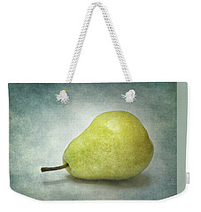 Weekender Tote Bag featuring the photograph Plump Pear by Kathi Mirto