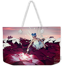 Weekender Tote Bag featuring the digital art Poinsettia Snow Fairy by Methune Hively