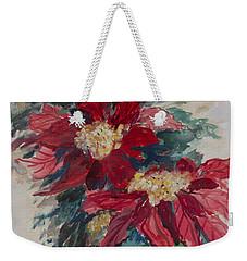 Poinsettias In A Brown Vase Weekender Tote Bag by Avonelle Kelsey