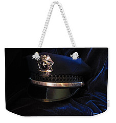 Weekender Tote Bag featuring the photograph Police Hat by Laurianna Taylor