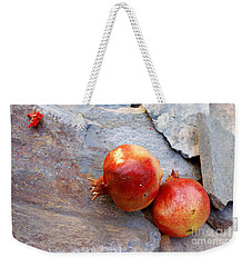 Weekender Tote Bag featuring the photograph Pomegranates On Stone by Cindy Garber Iverson