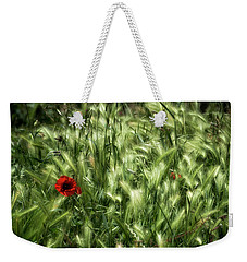 Weekender Tote Bag featuring the photograph Poppies In Wheat by Raffaella Lunelli