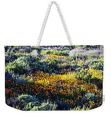 Weekender Tote Bag featuring the photograph Poppies On A Hillside by Glenn McCarthy Art and Photography