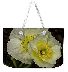 Weekender Tote Bag featuring the photograph Poppy Pair by Jean Noren