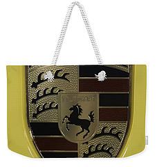 Porsche Emblem On Racing Yellow Weekender Tote Bag by Sebastian Musial