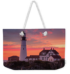 Weekender Tote Bag featuring the photograph Portland Head Light Sun Set  by Emmanuel Panagiotakis