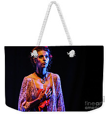 Weekender Tote Bag featuring the photograph Portrait Of Ballet Dancer In Pose On Stage by Dimitar Hristov