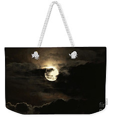 Weekender Tote Bag featuring the photograph Post Solstice Moon by Angela J Wright