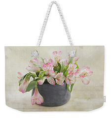 Weekender Tote Bag featuring the photograph Pot Of Pink Alstroemeria by Kim Hojnacki