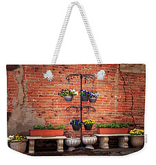 Weekender Tote Bag featuring the photograph Potted Plants And A Brick Wall by James Eddy