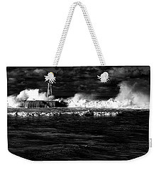 Weekender Tote Bag featuring the photograph Pounding The Breakwater by Nareeta Martin