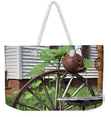 Weekender Tote Bag featuring the photograph Pouring Out The Past by Benanne Stiens