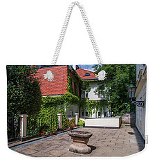 Weekender Tote Bag featuring the photograph Prague Courtyards by Jenny Rainbow