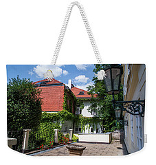 Weekender Tote Bag featuring the photograph Prague Courtyards. Old Lantern by Jenny Rainbow