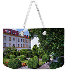 Weekender Tote Bag featuring the photograph Prague Courtyards. Regular Style Garden by Jenny Rainbow