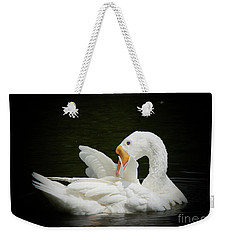 Weekender Tote Bag featuring the photograph Preening by Lisa L Silva