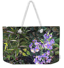 Weekender Tote Bag featuring the photograph Pretty Purple Flowers by Artistic Panda