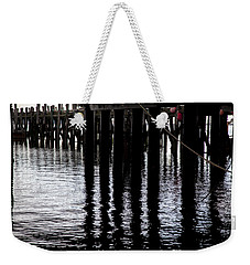 Weekender Tote Bag featuring the photograph Provincetown Wharf Reflections by Charles Harden