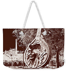Weekender Tote Bag featuring the photograph A Face Of Public Art by Lorraine Devon Wilke