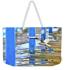 Weekender Tote Bag featuring the photograph Puddles by Diana Angstadt