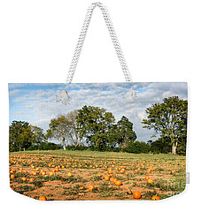 Weekender Tote Bag featuring the photograph Pumpkin Patch by Todd Blanchard