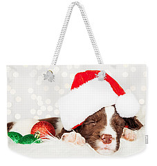 Puppy Wearing Santa Hat While Napping On Fur At Home Weekender Tote Bag
