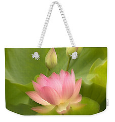 Weekender Tote Bag featuring the photograph Purity Reborn by John Poon