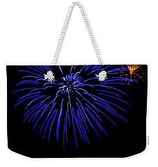 Weekender Tote Bag featuring the photograph Purple And Yellow Fireworks by Suzanne Luft