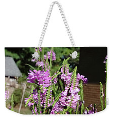 Weekender Tote Bag featuring the photograph Purple Bliss by Nick Kirby