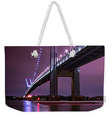 Weekender Tote Bag featuring the photograph Purple Bridge by Edgars Erglis