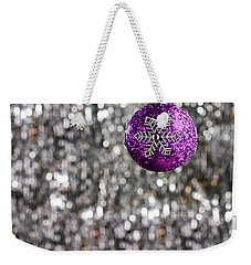 Weekender Tote Bag featuring the photograph Purple Christmas Bauble  by Ulrich Schade
