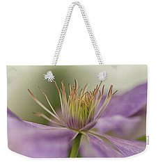Weekender Tote Bag featuring the photograph Purple Clematis Macro by Jacqi Elmslie