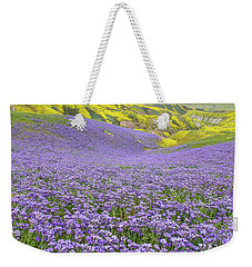 Weekender Tote Bag featuring the photograph Purple  Covered Hillside by Marc Crumpler
