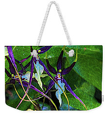 Weekender Tote Bag featuring the photograph Purple Dancers by Richard Goldman