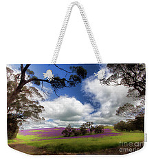 Weekender Tote Bag featuring the photograph Purple Fields by Douglas Barnard