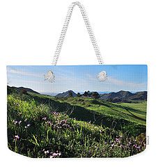 Weekender Tote Bag featuring the photograph Purple Flowers And Green Hills Landscape by Matt Harang