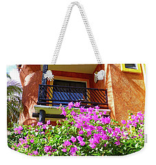 Weekender Tote Bag featuring the photograph Purple Flowers By The Balcony by Francesca Mackenney