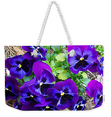 Weekender Tote Bag featuring the photograph Purple Pansies by Sandi OReilly